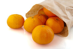 Paper bag with tangerine Stock Photos