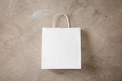 Paper bag on textured background. Mockup for design Stock Photography