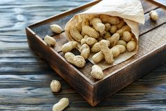 Paper bag with unshelled peanuts. Stock Photography