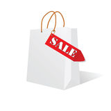 Paper bag white color with sale label Stock Images