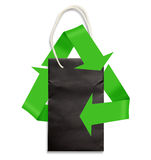 Paper bag on white with green recycling symbol. Black paper bag on white with shadow, with recycling symbol Stock Image