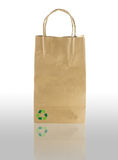 Paper bag on white with shadow  and recycle symbol.  Royalty Free Stock Photo