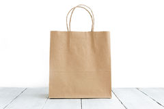 Paper bag on the wooden background Royalty Free Stock Image