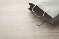 Paper bag on a wooden background Royalty Free Stock Image