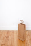 Paper bag on wooden floor Stock Photo