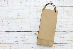 Paper bag on a wooden texture Stock Photography