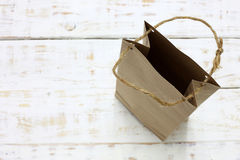 Paper bag on a wooden texture Stock Images