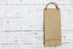 Paper bag on a wooden texture Royalty Free Stock Image
