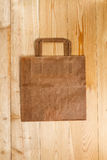 Paper bag on a wooden texture Stock Image