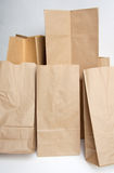Paper bags. It is diffrent size paper bags on white Stock Photos