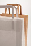 Paper bags. On white background. Consumerism symbol Stock Image