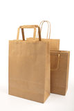 Paper bags. On white background. Consumerism symbol Stock Photography