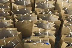 Paper bags. Many paper bags, only a single blue item can be senn in one of them Royalty Free Stock Image