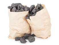 Paper bags with coal. On white background Stock Images