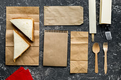 Paper bags in delivery concept on gray table background top view mockup. Paper bags with sandwich in delivery concept on gray table background top view mockup Royalty Free Stock Photos