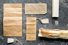 Paper bags in delivery concept on gray table background top view mockup Royalty Free Stock Photo