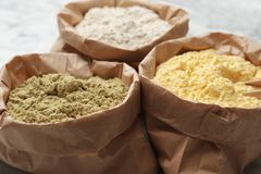 Paper bags with different types of flour,. Closeup royalty free stock photo