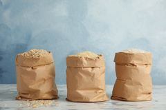 Paper bags with different types of rice on table. Paper bags with different types of rice on marble table stock photography