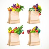 Paper bags filled with organic food fruits and vegetables Stock Photo