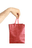 Paper bags in male hand Stock Image