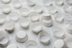 Paper baking molds for cupcakes or muffin on white table. Stock Photo