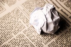Paper ball on newspaper Royalty Free Stock Photos