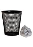 Paper ball next to black pencil holder Royalty Free Stock Photography