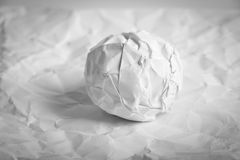 Paper Ball on wrinkled paper Royalty Free Stock Image