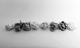 Paper balls on a line in black and white royalty free stock images