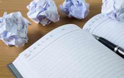 Paper balls and pen over blank white sheet Stock Images