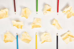 Paper Balls and pencils on white background. royalty free stock photography