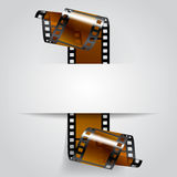 Paper banner with a brown curled film strip. Movies concept. There is in addition a vector format EPS 8 Royalty Free Stock Images