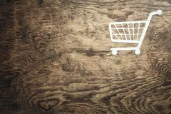 Paper basket on a wooden background. Shopping concept stock images
