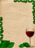 Paper in beige color tone with ornament in form of glass of wine and green leaves Royalty Free Stock Image
