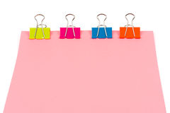 Paper binded by four clips Stock Photography