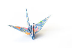 Paper bird. An origami bird with birds-pattern on a white background. Shallow depth of field, focus on the head royalty free stock photography