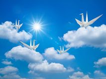 Paper bird in Bright blue sky Stock Images