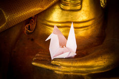Paper Bird in Hand Buddha Stock Photography