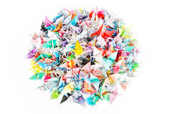 Paper birds. A circle pile of paper cranes isolated on a white background stock image