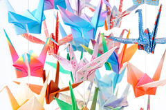 Paper Birds. Multicolour paper cranes. Soft focus and shallow depth of field. Focus on the pink bird in the middle royalty free stock photos