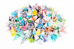 Paper birds. A pile of paper cranes isolated on a white background Royalty Free Stock Photography