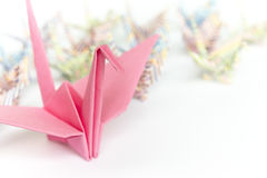 Paper birds. A big pink paper bird and a group of small paper birds, shallow depth of field Stock Images