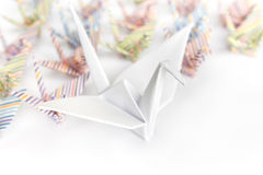 Paper birds. A big white paper bird and a group of small paper birds, shallow depth of field stock photo