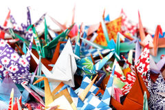 Paper birds background. A pile of colourful origami birds Royalty Free Stock Images