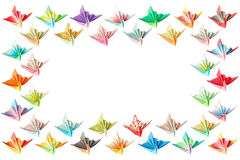 Paper birds frame. Colourful paper birds arranged as a rectangle frame and isolated on a white background Royalty Free Stock Photos