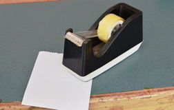 Paper and black tape dispenser on counter cashier in shop Stock Photos