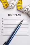 Paper with blank diet plan, pen and measure tape Royalty Free Stock Images