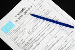 Paper blank form Schengen visa with a fountain pen