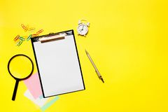 Paper blank with office supplies on a yellow background. Concept of new job, hiring recruitment process, new team members. Screening stock photography