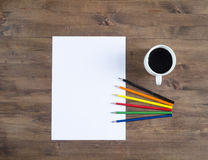 Paper blank Sheet, color pencils and a cup of coffee Royalty Free Stock Photos